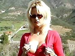 Sexy blond masturbates outdoors.Solo Gigrl.Slip nipple!