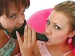 Hot lesbian gets dildo in..
