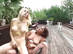 Mature lesbians share dildo..