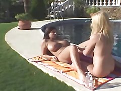 Beautiful lesbians relax by..