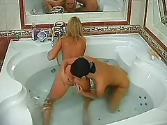 Brunette and blonde playing in bath.Ass licking!