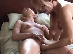 Two lesbians caress and lick..