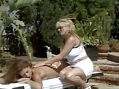 Mature lesbian spoils chick by pool.Busty Girls!