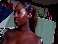 Ebony hottie uses a..