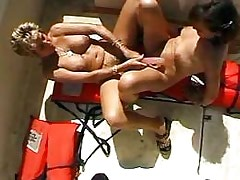 Lesbians enjoy sex toys.Lesbian double dildo!